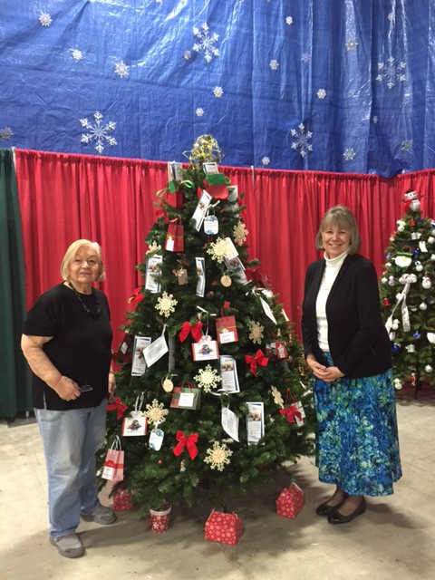 Elaine McDonald and Marilyn Perry setting up our tree.  Thank you!